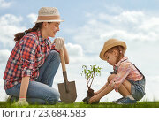 Купить «girl plant sapling tree», фото № 23684583, снято 27 февраля 2016 г. (c) Константин Юганов / Фотобанк Лори