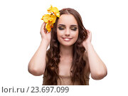 Купить «Young woman with orchid flower isolated on white», фото № 23697099, снято 24 августа 2016 г. (c) Elnur / Фотобанк Лори