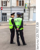 Купить «Russian police patrol officers of the State Automobile Inspectorate regulate traffic on city street», фото № 23707139, снято 11 сентября 2016 г. (c) FotograFF / Фотобанк Лори
