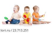 Купить «Children playing with musical toys», фото № 23713251, снято 10 февраля 2012 г. (c) Оксана Кузьмина / Фотобанк Лори