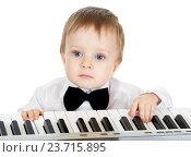 Купить «adorable child playing electronic piano», фото № 23715895, снято 2 декабря 2011 г. (c) Оксана Кузьмина / Фотобанк Лори