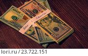 Купить «Стопки денег на разные расходы», видеоролик № 23722151, снято 29 сентября 2016 г. (c) Pavel Biryukov / Фотобанк Лори