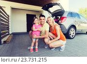 Купить «happy family with hatchback car at home parking», фото № 23731215, снято 11 августа 2015 г. (c) Syda Productions / Фотобанк Лори