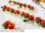 Купить «close up of mozzarella and cherry tomato canape», фото № 23731435, снято 11 июня 2016 г. (c) Syda Productions / Фотобанк Лори