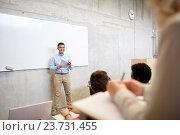 Купить «group of students and teacher at lecture», фото № 23731455, снято 19 июня 2016 г. (c) Syda Productions / Фотобанк Лори