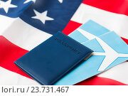 american flag, passport and air tickets. Стоковое фото, фотограф Syda Productions / Фотобанк Лори