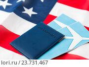Купить «american flag, passport and air tickets», фото № 23731467, снято 30 июня 2016 г. (c) Syda Productions / Фотобанк Лори