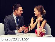 Купить «man proposing to his girlfriend at restaurant», фото № 23731551, снято 9 марта 2014 г. (c) Syda Productions / Фотобанк Лори