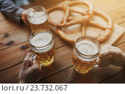 Купить «close up of hands with beer mugs at bar or pub», фото № 23732067, снято 22 июля 2016 г. (c) Syda Productions / Фотобанк Лори