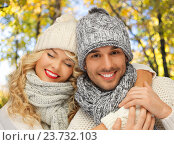 Купить «happy couple in warm clothes over autumn», фото № 23732103, снято 7 октября 2012 г. (c) Syda Productions / Фотобанк Лори