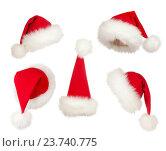 Купить «set of Christmas Santa hats», фото № 23740775, снято 10 ноября 2011 г. (c) Оксана Кузьмина / Фотобанк Лори