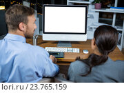 Купить «Business executives working on computer», фото № 23765159, снято 2 июня 2016 г. (c) Wavebreak Media / Фотобанк Лори
