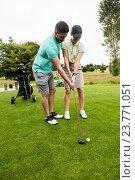 Купить «Male instructor assisting woman in learning golf», фото № 23771051, снято 20 июля 2016 г. (c) Wavebreak Media / Фотобанк Лори