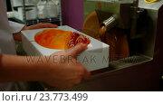 Купить «Worker filling mould with melted chocolate», видеоролик № 23773499, снято 9 апреля 2020 г. (c) Wavebreak Media / Фотобанк Лори