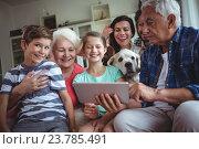 Купить «Happy multi-generation family using digital tablet in living room», фото № 23785491, снято 1 июля 2016 г. (c) Wavebreak Media / Фотобанк Лори