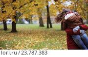 Купить «happy young couple meeting in autumn park», видеоролик № 23787383, снято 12 октября 2016 г. (c) Syda Productions / Фотобанк Лори