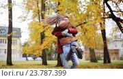 Купить «happy young couple having fun in autumn park», видеоролик № 23787399, снято 12 октября 2016 г. (c) Syda Productions / Фотобанк Лори