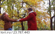 Купить «happy young couple having fun in autumn park», видеоролик № 23787443, снято 12 октября 2016 г. (c) Syda Productions / Фотобанк Лори