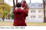 Купить «happy young couple meeting in autumn park», видеоролик № 23787483, снято 12 октября 2016 г. (c) Syda Productions / Фотобанк Лори