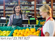 Купить «Smiling staffs checking fruits in organic section», фото № 23787827, снято 17 мая 2016 г. (c) Wavebreak Media / Фотобанк Лори