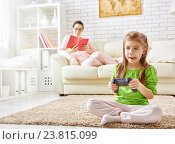 Купить «child playing video games», фото № 23815099, снято 7 декабря 2015 г. (c) Константин Юганов / Фотобанк Лори
