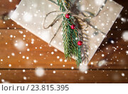 Купить «close up of christmas gift box with fir brunch», фото № 23815395, снято 7 октября 2015 г. (c) Syda Productions / Фотобанк Лори