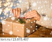Купить «close up of woman with christmas gift or parcel», фото № 23815407, снято 7 октября 2015 г. (c) Syda Productions / Фотобанк Лори