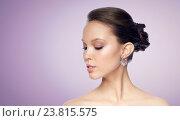 Купить «close up of beautiful woman face with earring», фото № 23815575, снято 9 апреля 2016 г. (c) Syda Productions / Фотобанк Лори