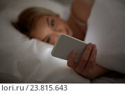 Купить «young woman with smartphone in bed at home bedroom», фото № 23815643, снято 30 апреля 2016 г. (c) Syda Productions / Фотобанк Лори