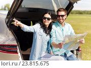Купить «happy man and woman with road map at hatchback car», фото № 23815675, снято 12 июня 2016 г. (c) Syda Productions / Фотобанк Лори