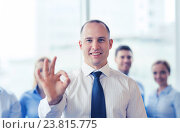 Купить «smiling businessman showing ok sign in office», фото № 23815775, снято 25 октября 2014 г. (c) Syda Productions / Фотобанк Лори