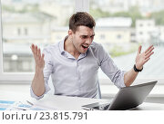 Купить «angry businessman with laptop and papers in office», фото № 23815791, снято 18 июня 2015 г. (c) Syda Productions / Фотобанк Лори