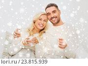 Купить «happy couple with cups drinking tea at home», фото № 23815939, снято 8 октября 2015 г. (c) Syda Productions / Фотобанк Лори