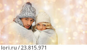 Купить «freezing couple in winter clothes wrapped to plaid», фото № 23815971, снято 7 октября 2012 г. (c) Syda Productions / Фотобанк Лори