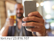 close up of man with smartphone and beer at pub. Стоковое фото, фотограф Syda Productions / Фотобанк Лори