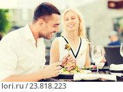 Купить «happy couple eating dinner at restaurant terrace», фото № 23818223, снято 15 июля 2015 г. (c) Syda Productions / Фотобанк Лори