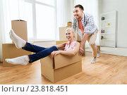Купить «couple with cardboard boxes having fun at new home», фото № 23818451, снято 6 июня 2015 г. (c) Syda Productions / Фотобанк Лори