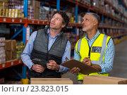 Купить «Warehouse workers checking the inventory», фото № 23823015, снято 23 марта 2016 г. (c) Wavebreak Media / Фотобанк Лори