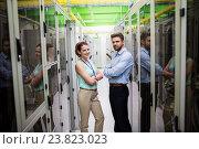 Купить «Technicians standing with arms crossed in a server room», фото № 23823023, снято 13 апреля 2016 г. (c) Wavebreak Media / Фотобанк Лори