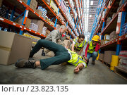 Купить «Worker fallen down while carrying cardboard boxes», фото № 23823135, снято 23 марта 2016 г. (c) Wavebreak Media / Фотобанк Лори