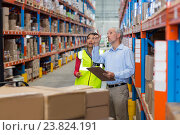 Купить «Warehouse manager and female worker interacting while checking inventory», фото № 23824191, снято 23 марта 2016 г. (c) Wavebreak Media / Фотобанк Лори