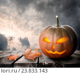 Купить «Fierce pumpkin on the table and dramatic sky», фото № 23833143, снято 24 июня 2013 г. (c) easy Fotostock / Фотобанк Лори