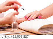 Купить «Young woman in nail treatment medical concept», фото № 23838227, снято 21 июля 2016 г. (c) Elnur / Фотобанк Лори