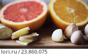 Купить «ginger, grapefruit, orange and garlic on board», видеоролик № 23860075, снято 18 октября 2016 г. (c) Syda Productions / Фотобанк Лори