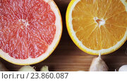 Купить «ginger, grapefruit, orange and garlic on board», видеоролик № 23860087, снято 18 октября 2016 г. (c) Syda Productions / Фотобанк Лори