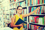 Young woman in book shop, фото № 23861951, снято 20 октября 2016 г. (c) Яков Филимонов / Фотобанк Лори