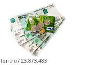 Купить «Монеты лежат на пластиковой карте и тысячных купюрах», эксклюзивное фото № 23873483, снято 18 октября 2016 г. (c) Катерина Белякина / Фотобанк Лори
