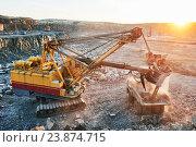 Купить «Mining. excavator loading granite or ore into dump truck», фото № 23874715, снято 8 сентября 2016 г. (c) Дмитрий Калиновский / Фотобанк Лори
