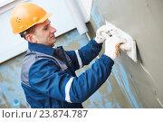 Купить «worker at plastering facade work», фото № 23874787, снято 5 февраля 2016 г. (c) Дмитрий Калиновский / Фотобанк Лори