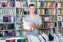 teenage boy with book pile in shop, фото № 23901499, снято 16 сентября 2016 г. (c) Яков Филимонов / Фотобанк Лори